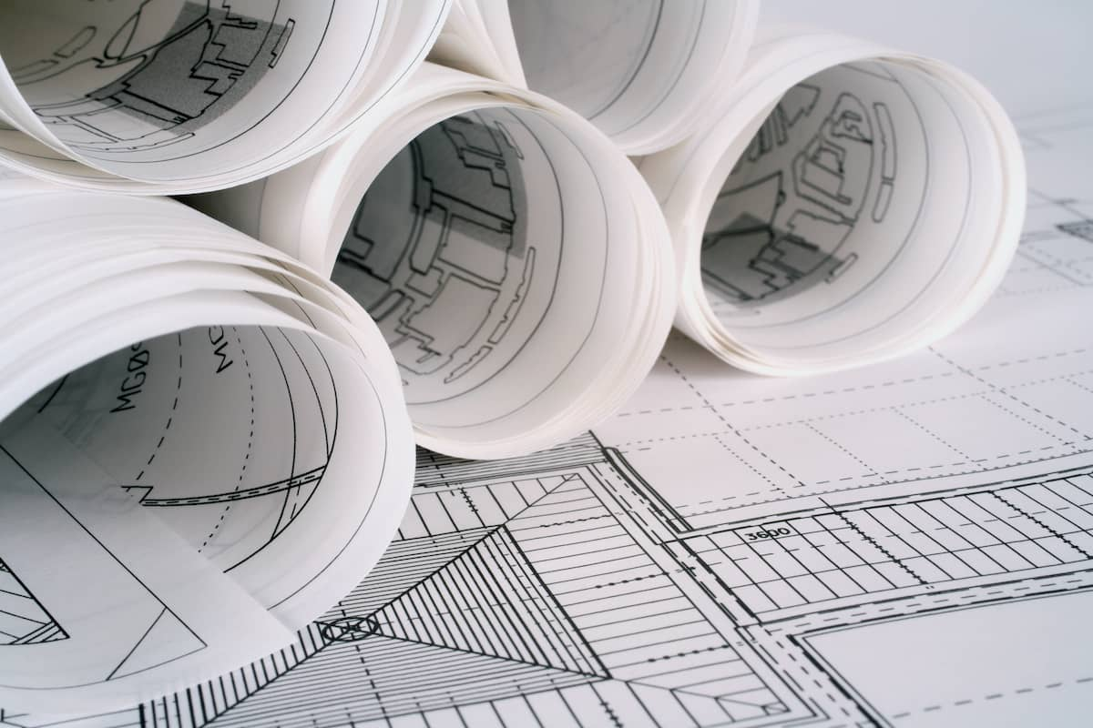 Architect drawings rolled up on a planning desk