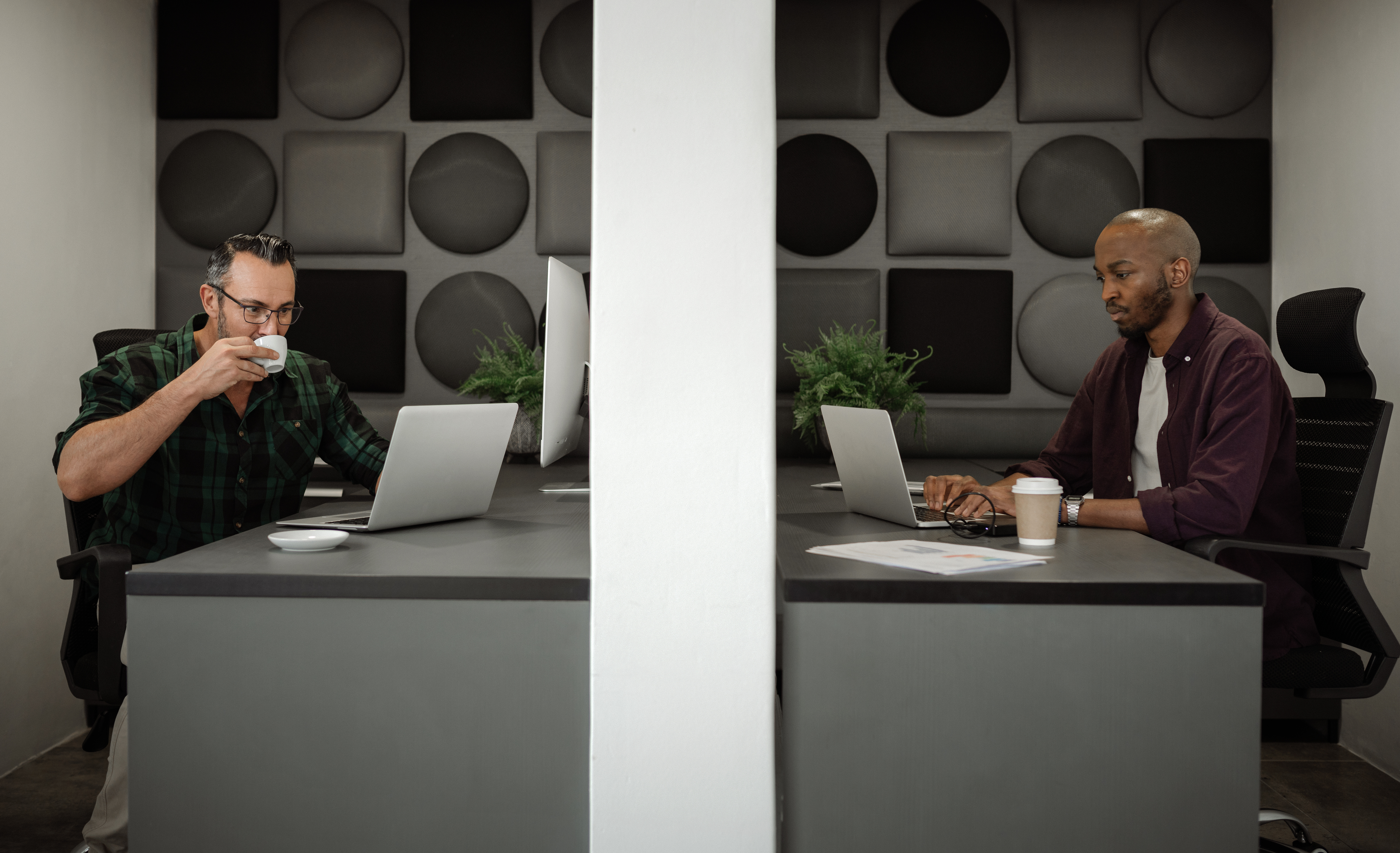 Two men working in private cubicles