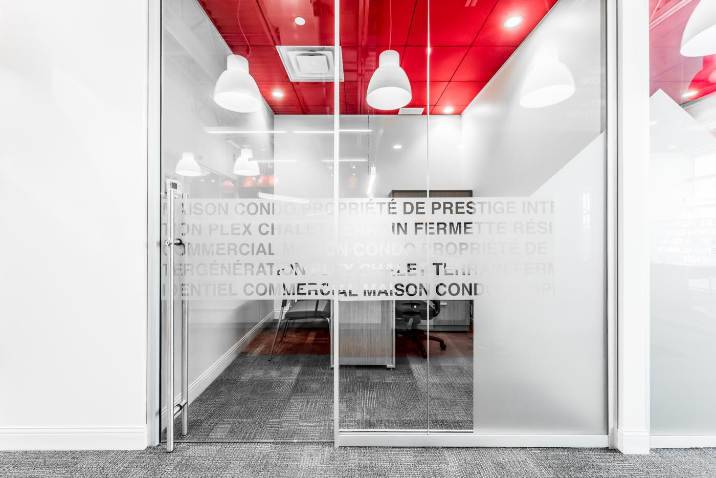 A glass office with typography on the architectural walls