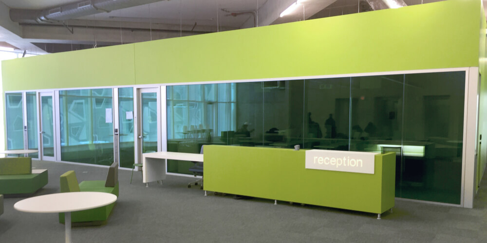 Ryerson Student Learning Centre reception area with green movable office walls