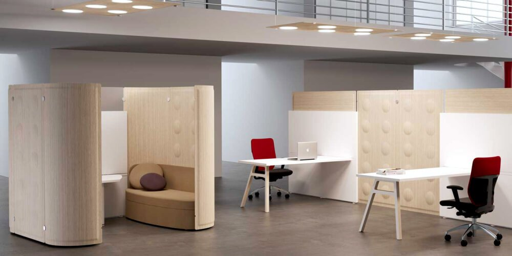 An open office space broken up with cubicle wall panels